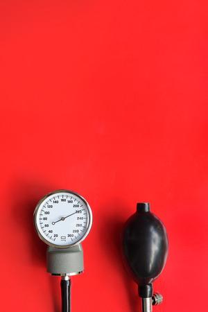 Blood pressure meter medical equipment on red background