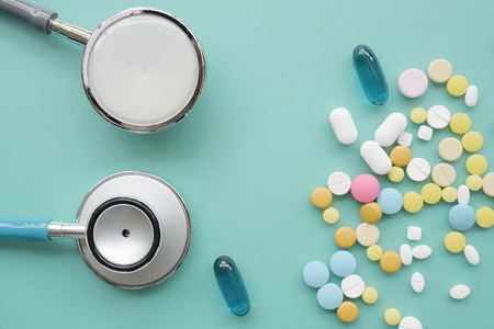 Different medication with stethoscope on blue background Banco de Imagens