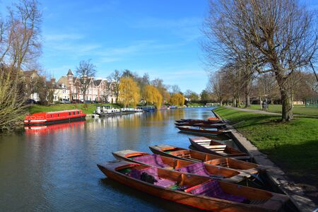 Typical river scene in Cambridge UK at Jesus green looking towards Jesus lock with punts and narrow boat. Stock fotó