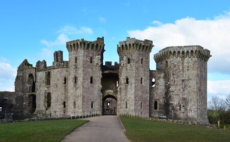 Raglan Castle in Monmouthshire Wales with its imposing towers and grand entranceway.
