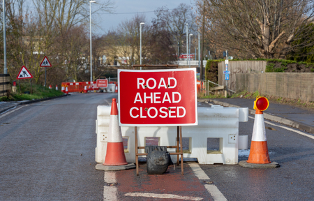 A Road Closed sign prevents drivers going down a street