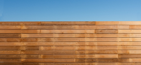 A wooden slatted fence around the boundary of a property for privacy 写真素材 - 126045588