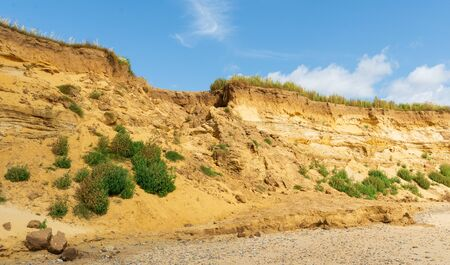 A gap in the sandstone cliffs at Covehithe Suffolk, UK, left by a rockfall due to erosion