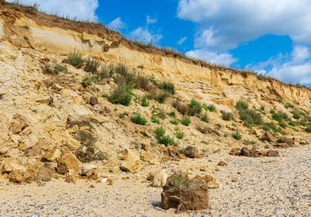 The cliffs at Covehithe beach in Suffolk UK are eroded and collapsing 写真素材