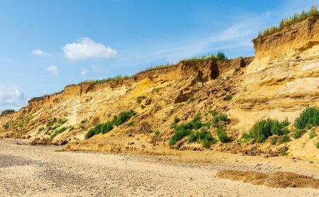 A rockfall, caused by erosion, has left a gap in the sandstone cliffs at Covehithe Suffolk, UK