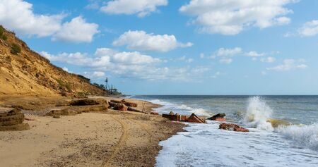 Some buildings have collapsed into the sea due to erosion of the cliffs at Covehithe in Suffolk, UK