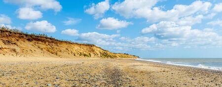 Covehithe Beach with its eroding  sandstone cliffs in Suffolk UK