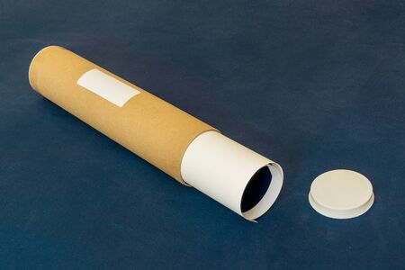A labelled packaging tube contains  delicate paper item ready to be delivered by courier Zdjęcie Seryjne