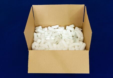 Glass in a box with bio-degradable packaging penuts