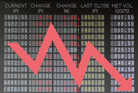 Trading board shows falling stocks prices with arrow