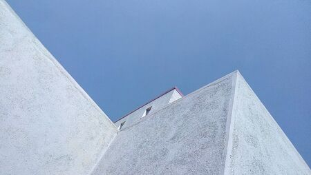 uncluttered: old minimalist building against clear blue sky