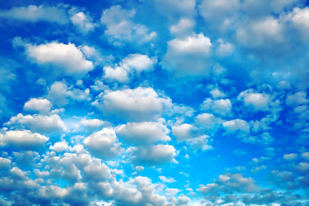 A lot of tiny white Clouds in a bright Blue Sky. Fluffy blue and white clouds are painted with a brush and oil. Bright cloudy sky. White tiny clouds background on blue sky. Photo processed by oil pain 스톡 콘텐츠