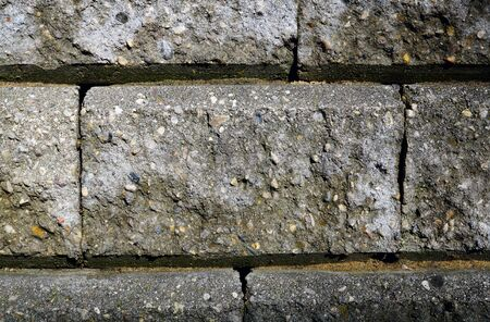 Part of a stone wall close-up. The structure of the stone interspersed with small pebbles 写真素材