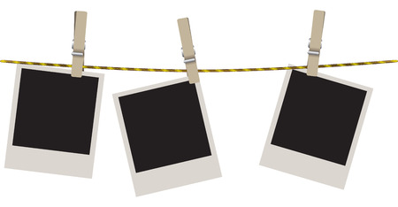 Polaroid shots on a clothesline with clothespins