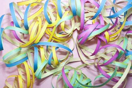 serpentines on violet background. Carnival, party decoration