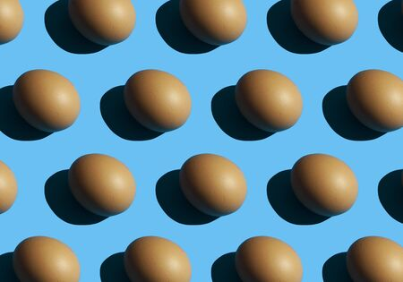 Egg pattern on blue background. repetitive, duplicate items. easter conception