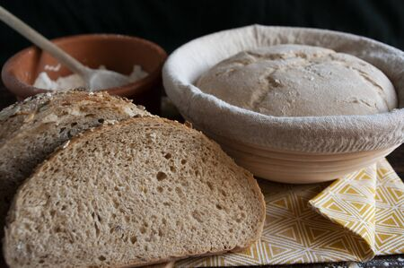 sourdough dough in proofing basket , whole wheat recipe. Rye flour bread slices. Home baked seed bread. Close up.