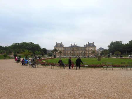 Paris, France - 4 june 2016: Jardin du Luxembourg Senat (Luxembourg palace) in Paris, France. People walking in garden of palace.
