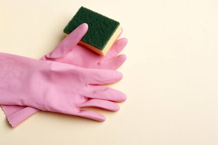 Pink rubber gloves and sponge, cleaning servise banner copy space text.