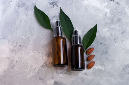 Natural cosmetic almond oil, glass droppers bottles. Body care.Copy space for text. Organic.