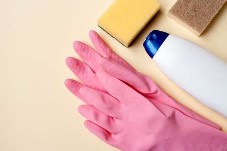 Supplies for cleaning, gloves, detergent, sponges. Copy space. Cleaning service and housework conception. Background. 免版税图像