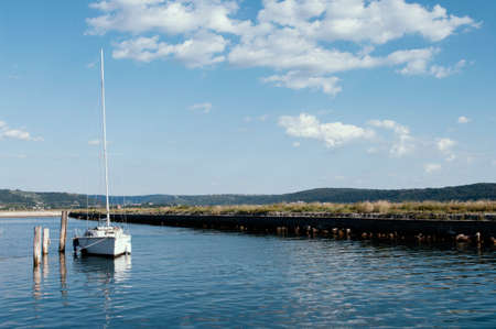 white yacht and blue water adriatic sea, Slovenia. Clear sky with small clouds. Nautical 免版税图像