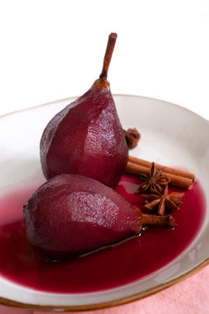Poached pears in red wine with spices. Sweet dessert, italian kitchen recipe.