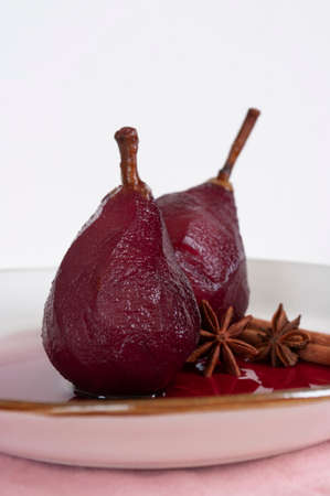 Poached pears in red wine with cinnamon. Fruit dessert, home made recipe.