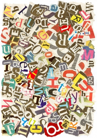Colorful background with letters torn from newspapers and magazines rough edges, messy look  photo