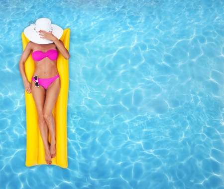Woman relaxing in a pool Stock Photo - 14227272