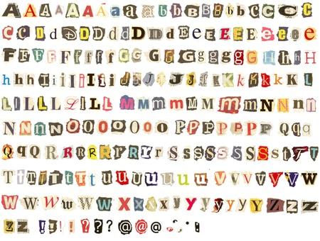 tatter: Alfabeto con letras de colores arrancados de peri�dicos y revistas, los bordes �speros, mirada sucia, perfecto para sus cartas amenazadoras mensuales Foto de archivo