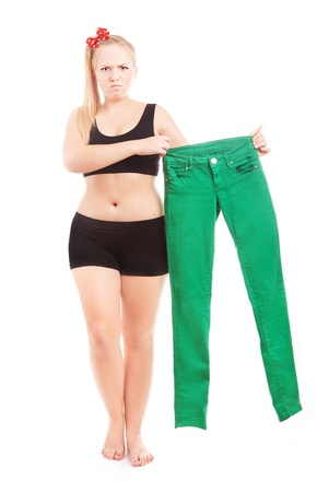 overweight students: Angry 40 size girl holding 36 size trousers