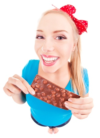 Funny excited girl with a chocolate isolated on white  photo