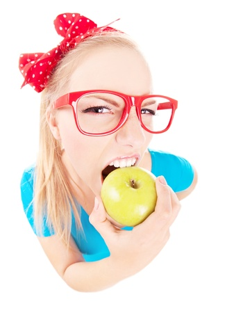 Funny girl biting an apple isolated on white photo