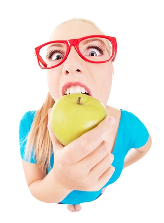 Funny girl biting an apple isolated on white Stock Photo - 16336394