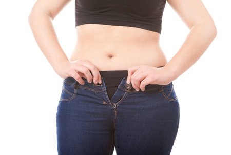 unzip: Size 40 woman zipping tight jeans, obesity and overweight concept  Stock Photo