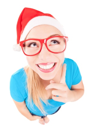 Photo of a funny Santa girl pointing up, fish eye lens used Stock Photo - 16336404