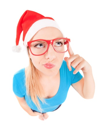 Brainstorm concept, funny Santa girl looking up Stock Photo - 16336419