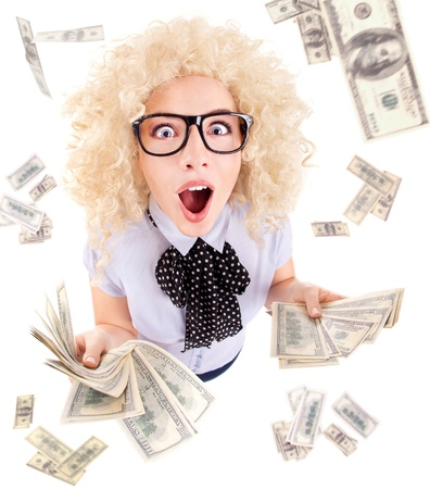 woman holding money: Millionaire, lottery winner concept, funny surprised excited woman with dollar bills  Stock Photo