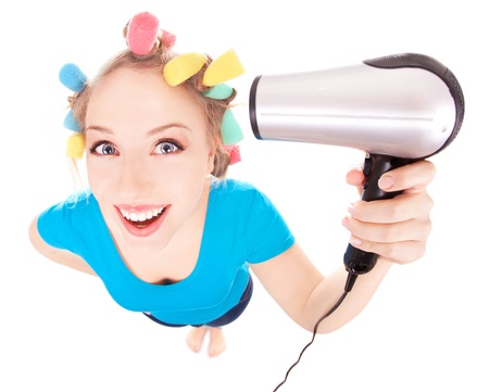 Funny girl styling hair, holding hairdryer  Stock Photo - 16336428