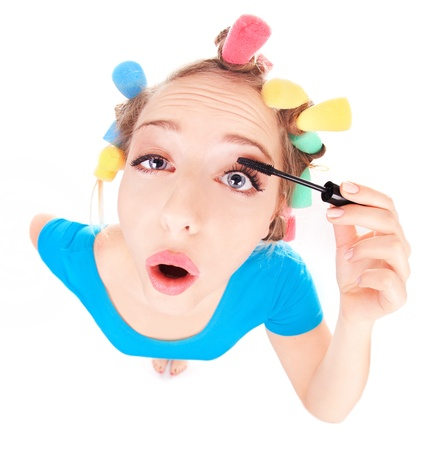 hair curler: Funny portrait of girl applying mascara