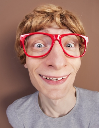 Funny nerdy guy wearing glasses photo