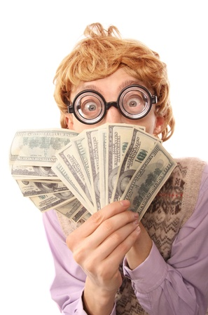 miserly: Nerdy guy with money Stock Photo