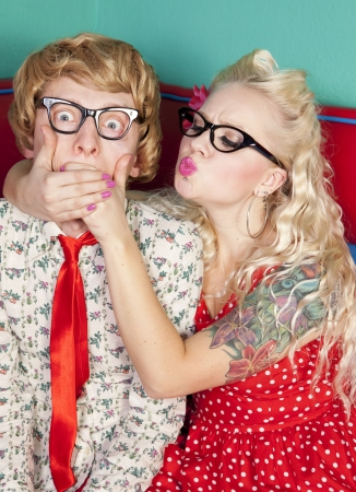 overpowered: Girlfriend is trying to kiss a shy nerdy guy Stock Photo