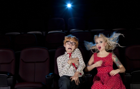 funny movies: Cinema date, shocked couple is watching a scary movie  Stock Photo