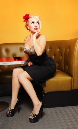 Pinup girl at a cafe  photo