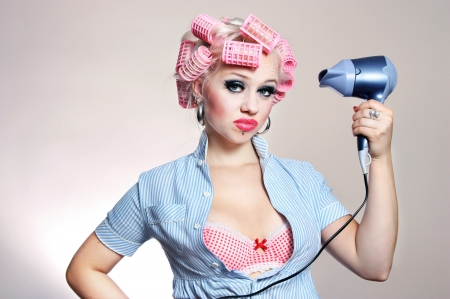curlers: Unhappy housewife with hairdryer Stock Photo