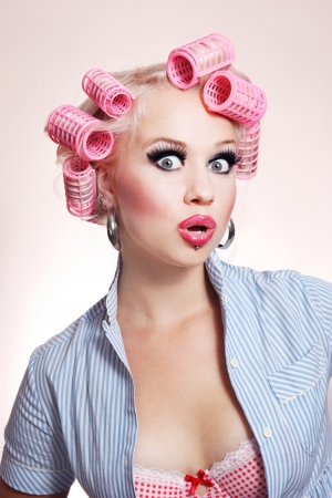 curlers: Surprised sexy housewife  Stock Photo