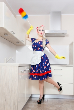 sexy housewife: Spring cleaning in the kitchen Stock Photo