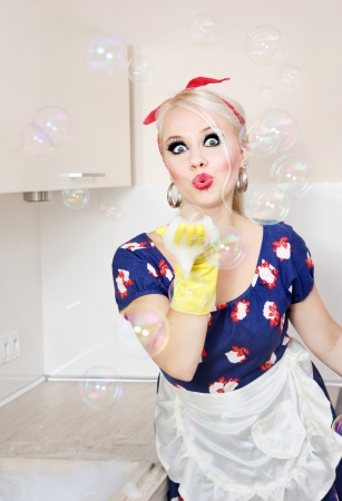 retro housewife: Housewife playing with soap bubbles
